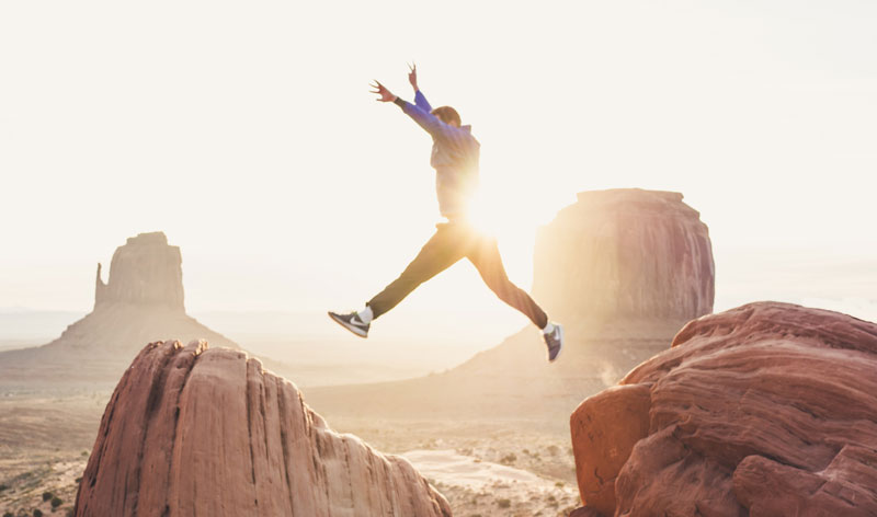 man jumping with confidence